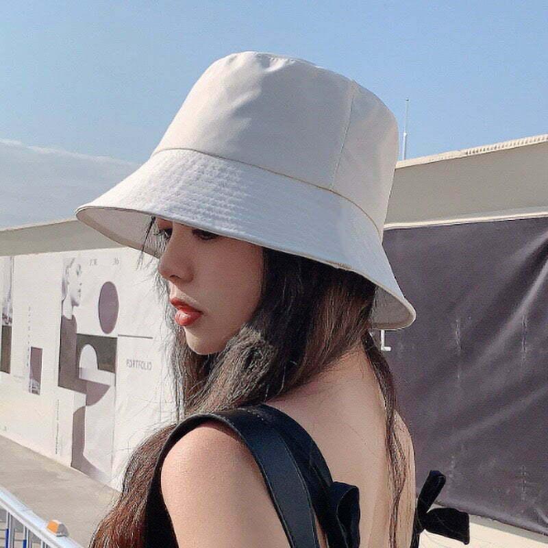 tóc dài đội mũ bucket